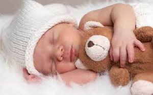 new born with teddy bear