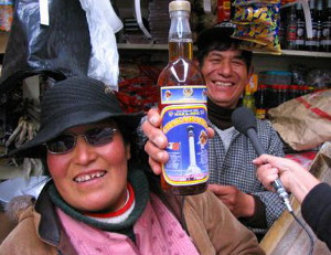Native Peruvians with bottled Maca drink