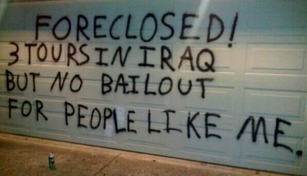 "Photo of Verteran's writing on a wall, ""Foreclosed! 3 tours in Iraq but no bailout for people like me."""