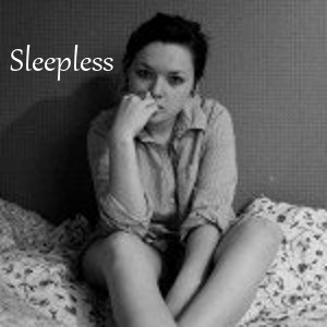 Sleepless - girl with dark circles under her eyes sitting on bed