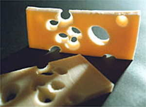 Photo of Swiss cheese with its characteristic holes made by propionibacterium freudenreichii