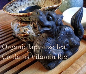 Photo of black tea and black ceramic dragon ~ Text: Organic Tead Contains Vitamin B12